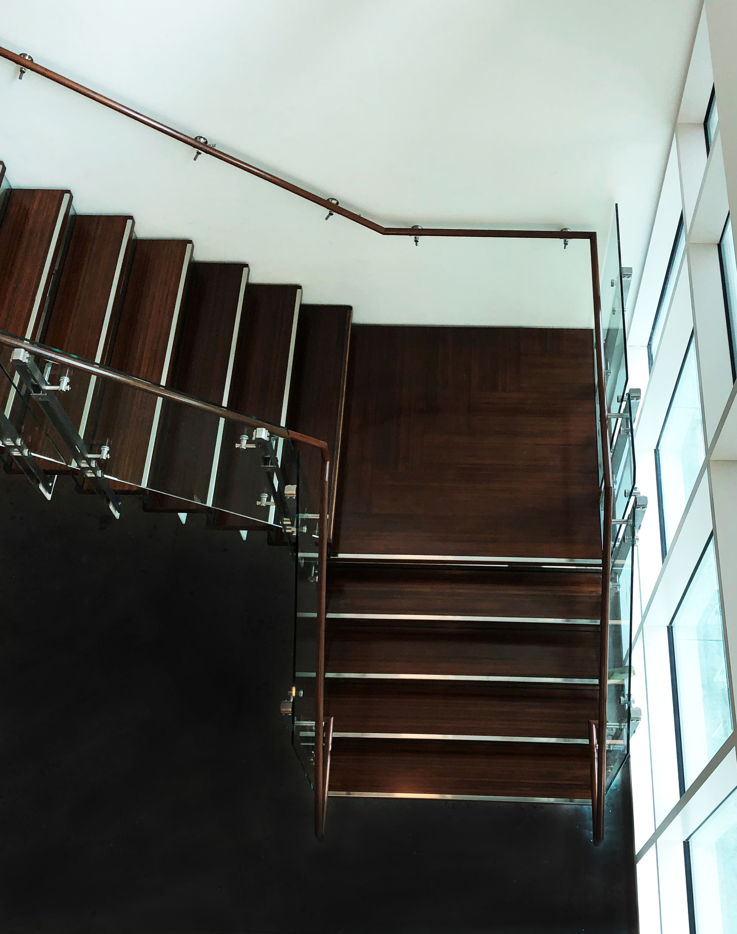 Featured indoor at the Vancouver Waterfront are Lamboo® Surface™ - Stair & Handrails.