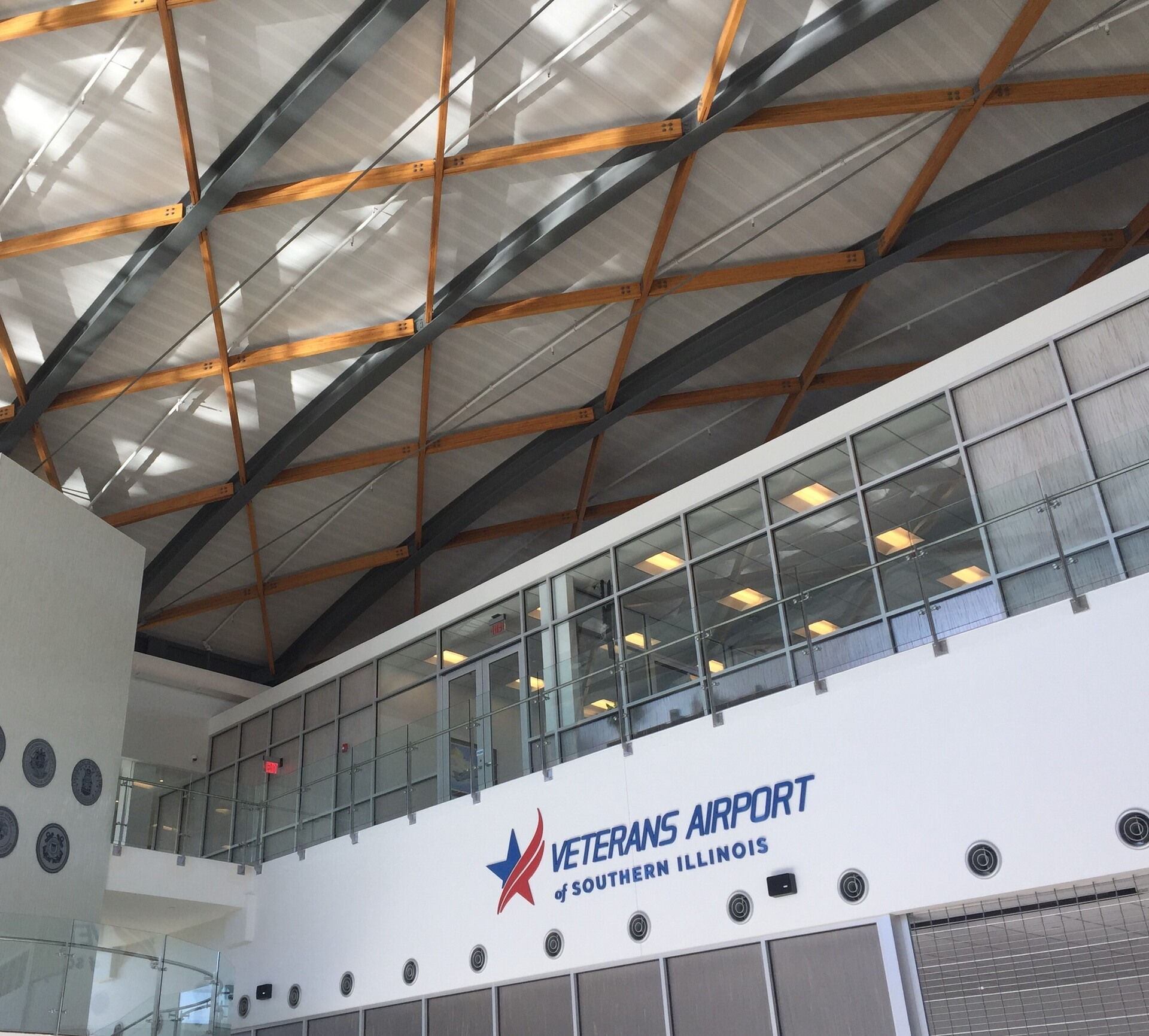 Veterans Airport, located in Marion, Illinois, features Lamboo® Structure™ Series - Cambered Structural Beams throughout the interior.