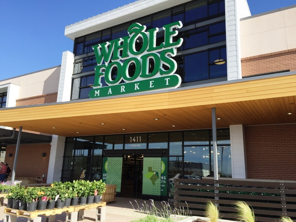Whole Foods, located in Richardson, Texas, featuring Lamboo® Rainscreen™ - Awning Soffit on the exterior.