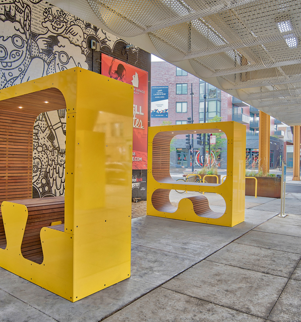 The bright yellow cubbies reinforce the playful and vibrant experience of the Lakeview Low-line.