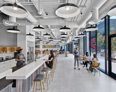 The open concept common area to break room at the Vans corporate headquarters in Costa Mesa, California, featuring the Original™ Warehouse Pendant by Barn Light Electric. Photos by Eric Laignel