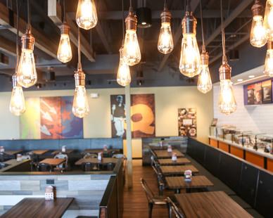 Beautiful lighting in the  QDOBA restaurant in Albert Lea, Minnesota by Larson Contracting.
