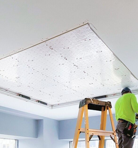To recreate the effect of natural daylight in the office space, the designer decides to use custom backlighting to build a large even ceiling illumination.