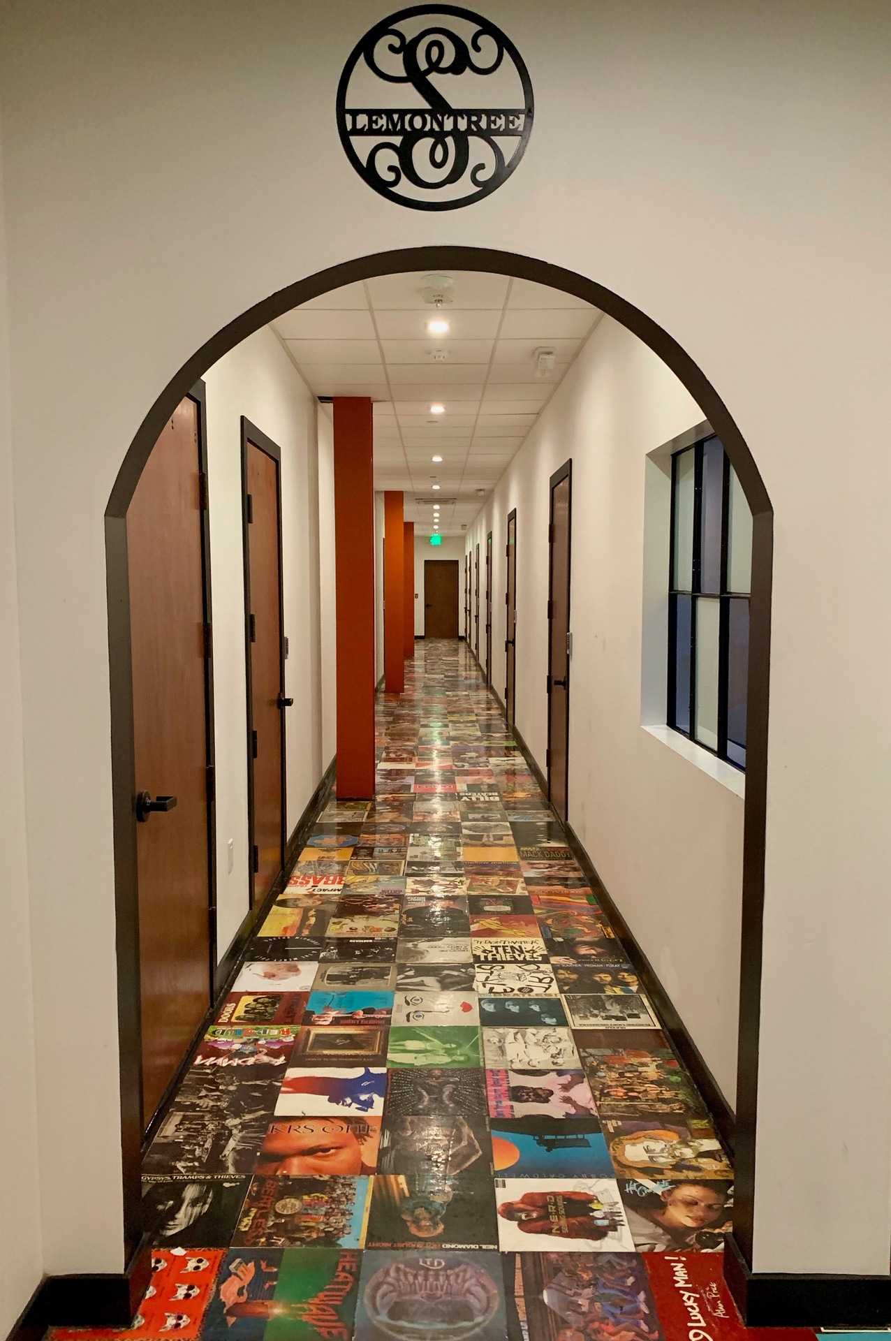 Walk down the hallway and look at the record album floor.  The arched doorway is a fun design element.  Sound reducing drywall was installed to make it a great recording studio with no sounds transferring between rooms.