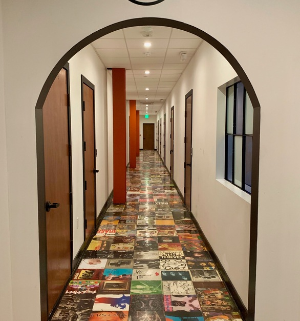 Walk down the hallway and look at the record album floor.  The arched doorway is a fun design element.