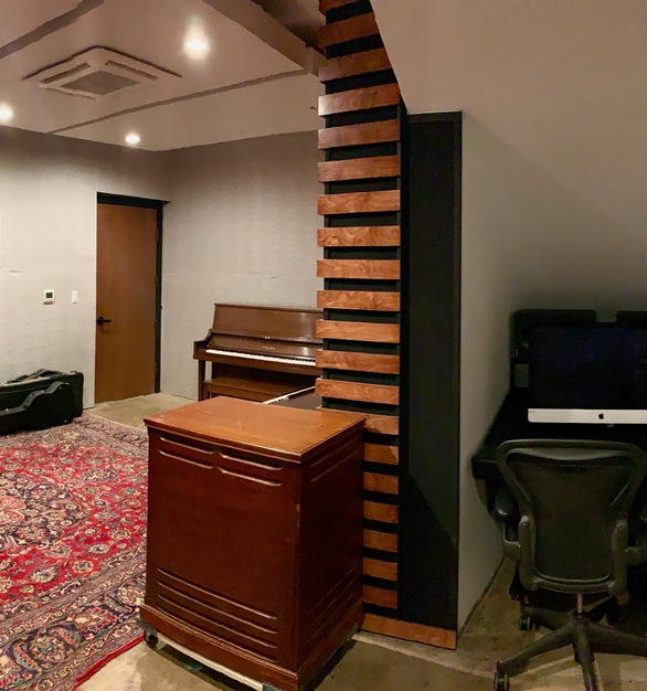 This recording studio is acoustically designed to create a space for artists to produce music.