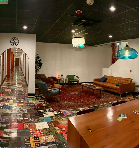 A panoramic view of the recording studio lounge.