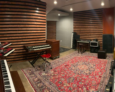 An acoustically designed music studio with independent double-wall framing, with the walls and ceiling not touching another studio--creating almost non-existent stound transfer between rooms.