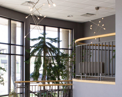 Stunning entryway full of greenery at the First Dakota Title office in Sioux Falls, SD designed by Lenae Design.