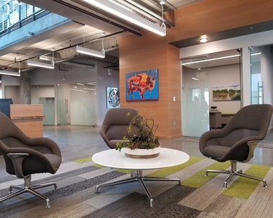 A waiting area within the lobby of Reliabank Mortgage in Sioux City, South Dakota shows off Lenae Design's impeccable interior design skills.