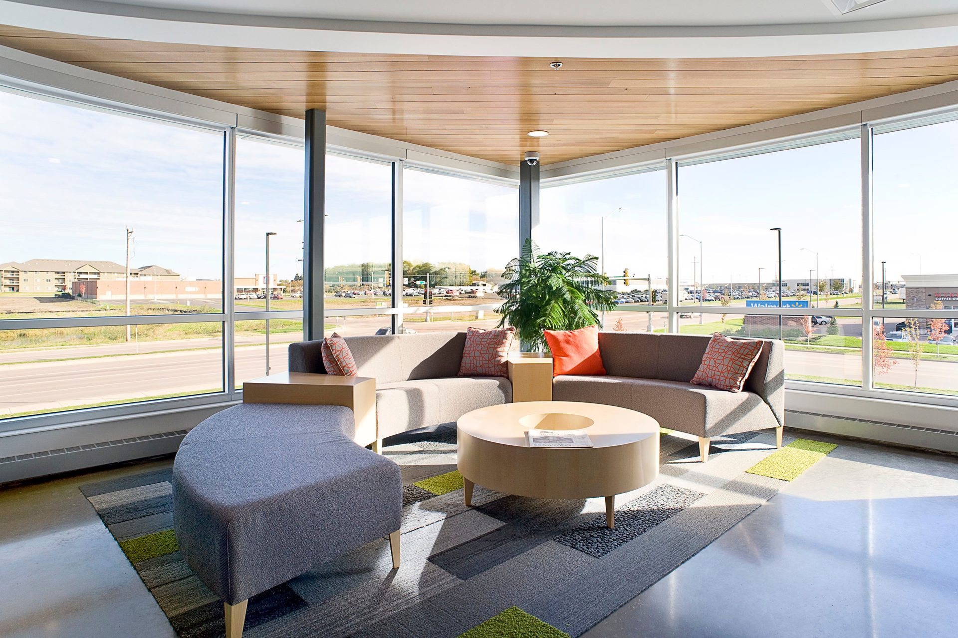 A beautiful, sunfilled waiting area at Reliabank Mortgage in Sioux Fall, South Dakota with interior design work completed by Lenae Design.