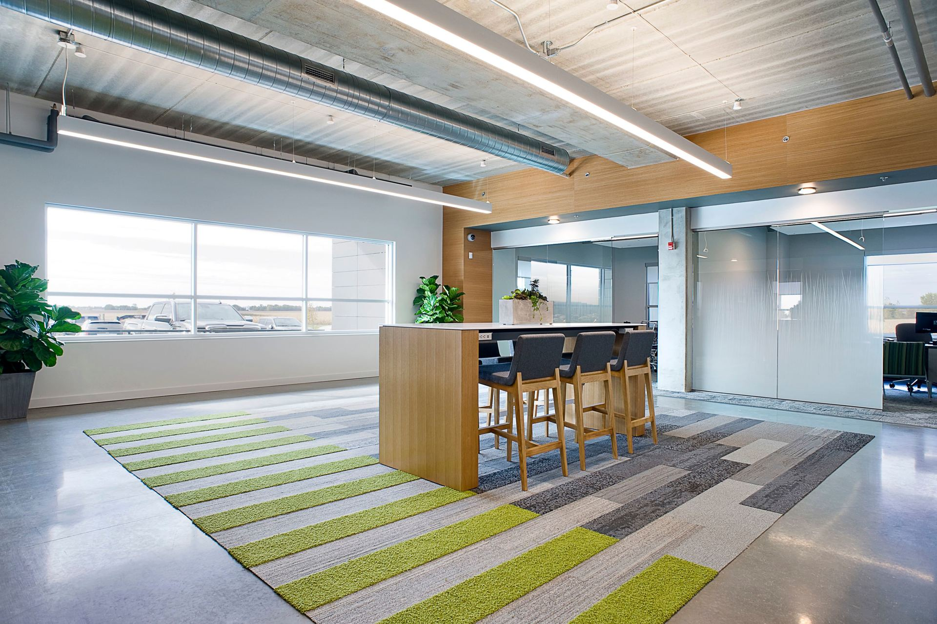 Open workspace is available for employees and clients of Reliabank Mortgage in Sioux Falls, South Dakota. Lenae Design kept the space clean and modern.