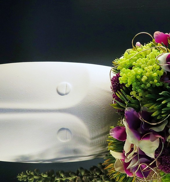 Headdress of purple orchids, sedum gold leaves and gold wire in a white matte porcelain head vase.