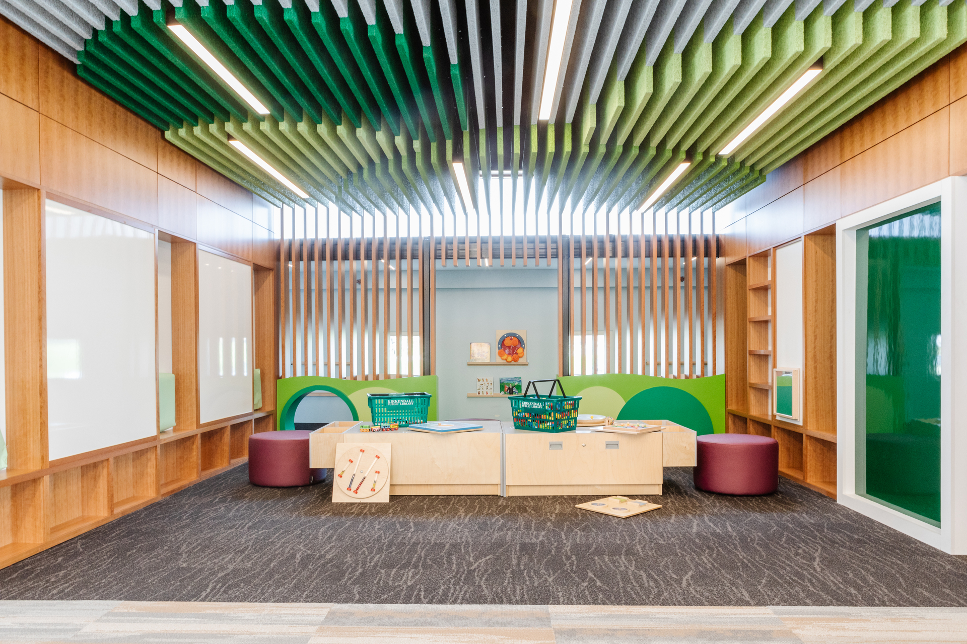 Library Children's Activity Area Whiteboards Linear Hanging Lights and Acoustic Ceiling Panels Stahl Construction General Contractor