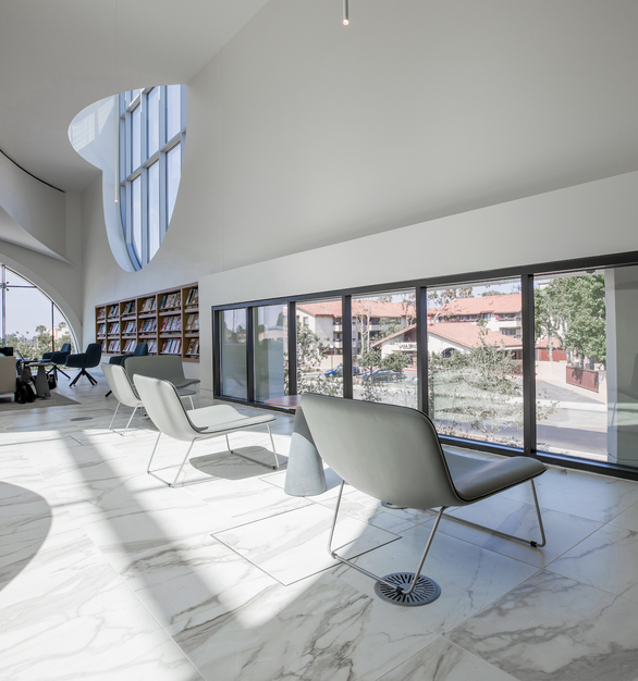 Large, comfortable seating allows library guests to sit and relax. The structural glass windows and arched glass designs add a stylish touch to the library.