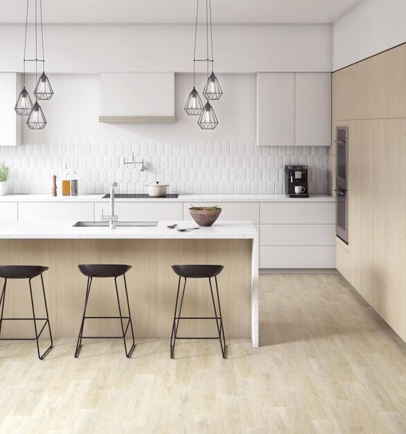 The light hues of the backsplash a wood flooring create an airy ambiance for the work breakroom area.