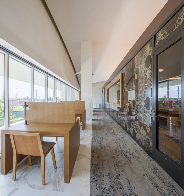 In total, the Donald Dugan Library has a 1,714 sq ft interior. The upper-level features workspace desks and meeting rooms with custom graphic glass.