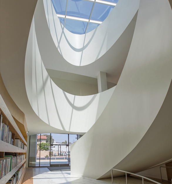 A closer view of the large skylight helps show just how much natural light it brings into the library. Not only is the entrance area and atrium illuminated, but the corridor and the entire area of the library is lit from the skylight.