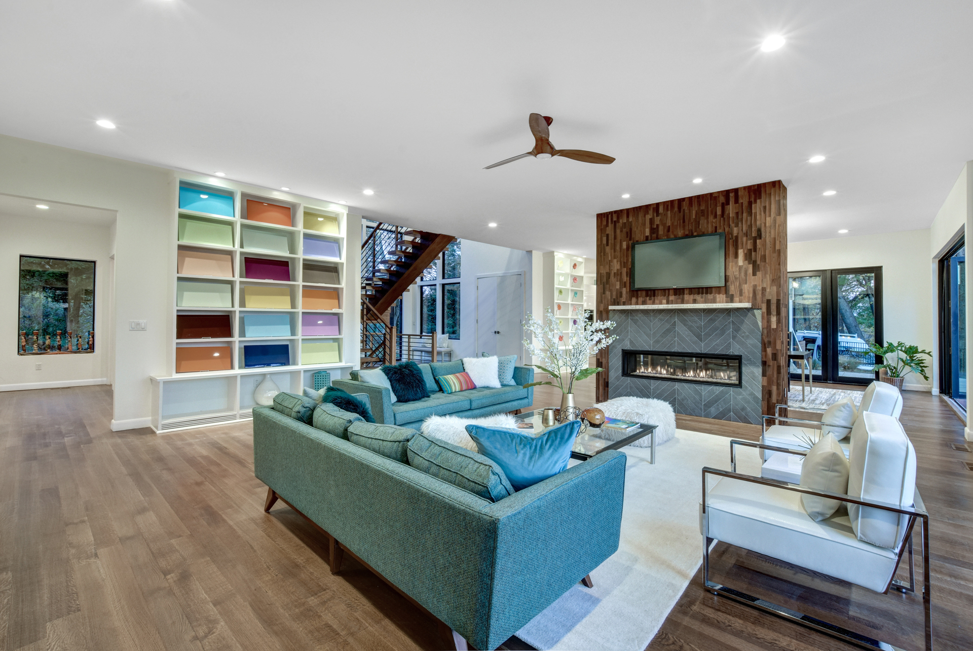 This New Jersey residence has a beautiful wood partition wall for the fireplace and tv.