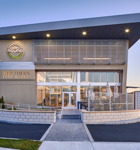 The Logan Airport Nouria Energy Convenience Center features approximately 10,000 square feet of Pure + FreeForm finishes and panels on both the exterior and interior.   Photography Credit: Joseph Ferraro Photography