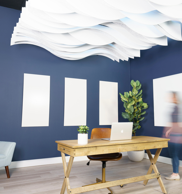 The curving sculptural shape of the Londe Baffle Ceiling System measurably improves visual and acoustic privacy within open office spaces.