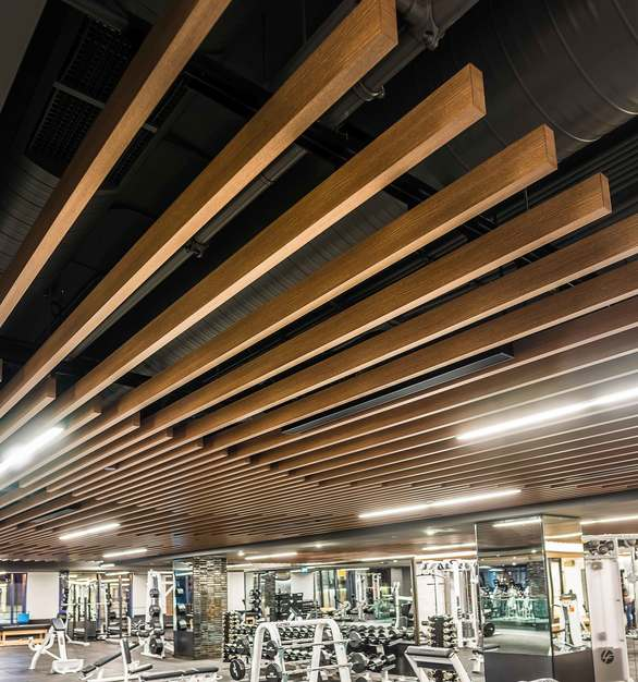 "To accomplish the elegant and modern aesthetic, this project features the Longboard®Ceiling System: 1.5"" X 4"" BEAM"