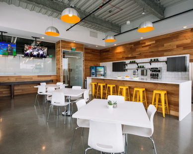 The break room at the Mall of America Corporate offices feature wood cladding to warms up the space.