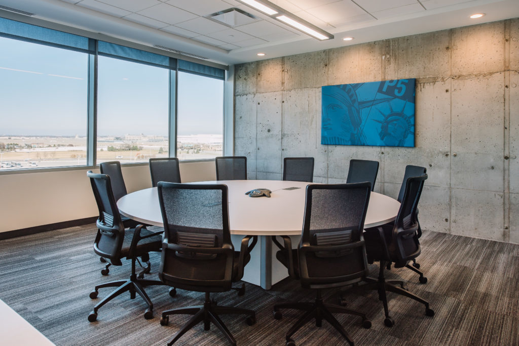 Large windows allow light to penetrate this conference room at the Mall of America Corporate Office.