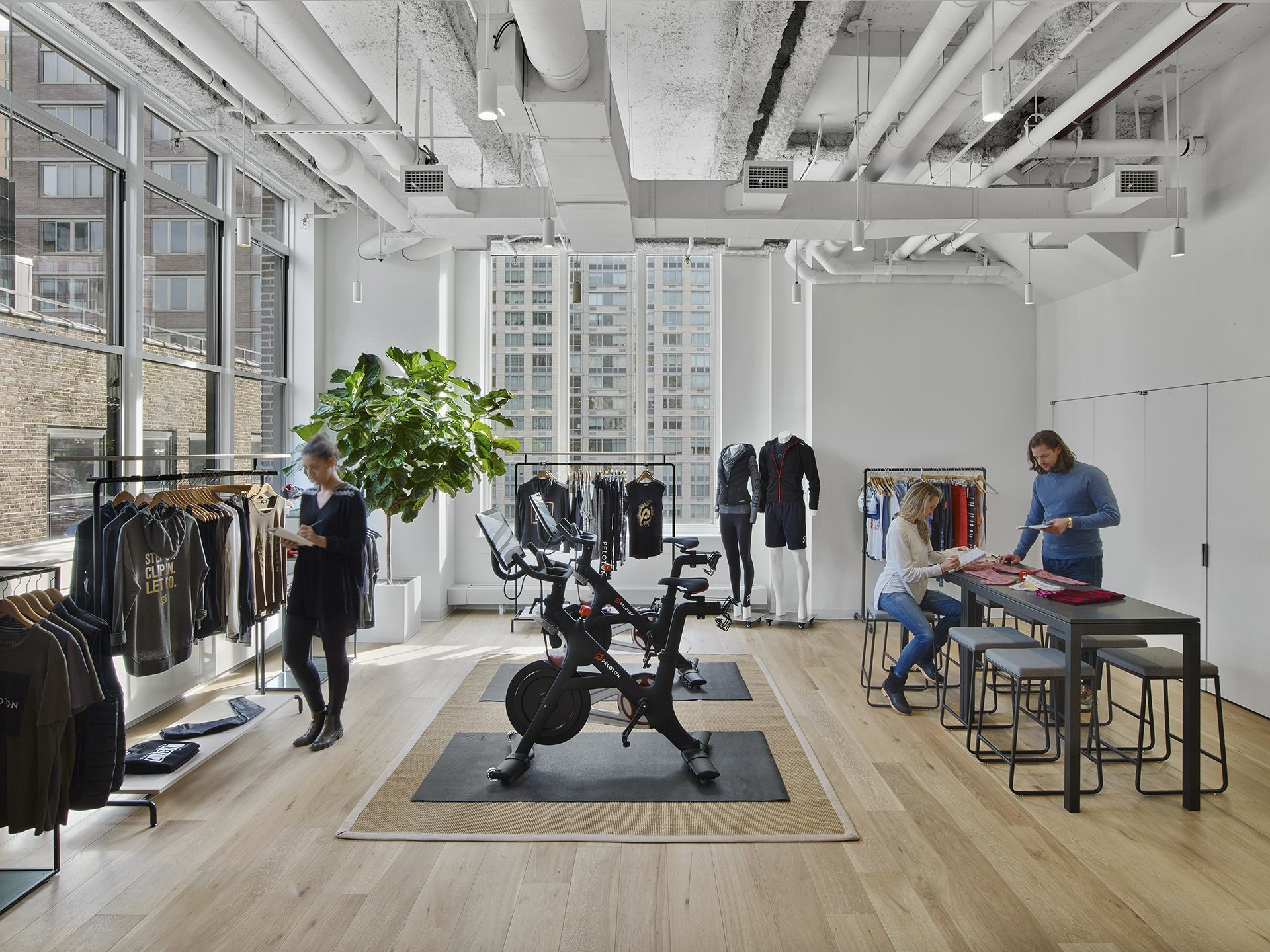 The Peloton apparel team has their own dedicated showroom just off the main entrance. This is where they can display merchandise for clients in a highly curated setting.