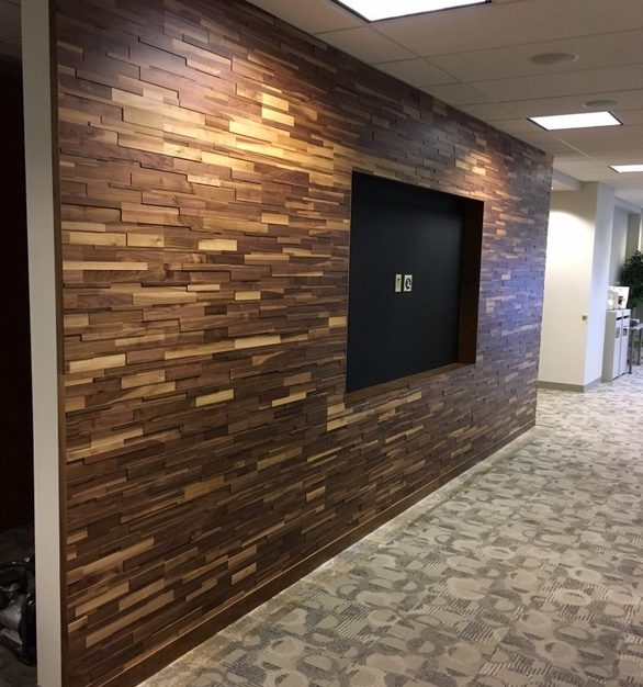The beautiful corridor wall design featuring textured interlocking wood planks by Materials Inc.
