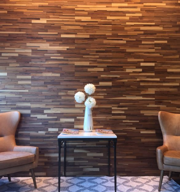 Up your waiting area design with textured interlocking wood planks by Materials Inc.