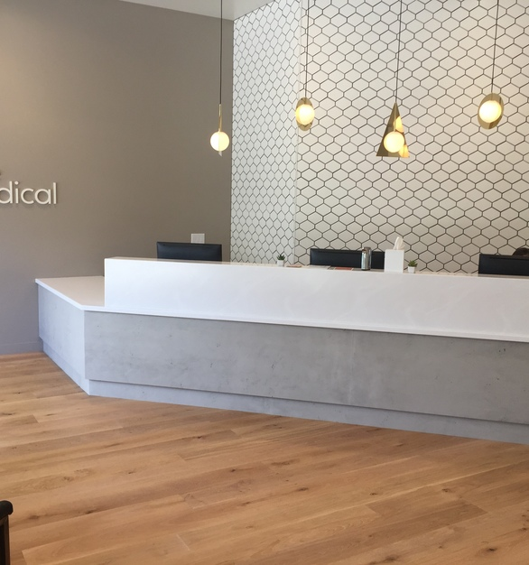 The reception area at One Medical in West Hollywood, California, features Aria Thin Concrete & Rust Sheets by Materials Inc.
