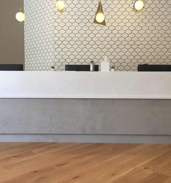 Incorporate Aria Thin Concrete and Rust Sheets by Materials Inc. as part of your lobby and reception design for a modern and clean look.