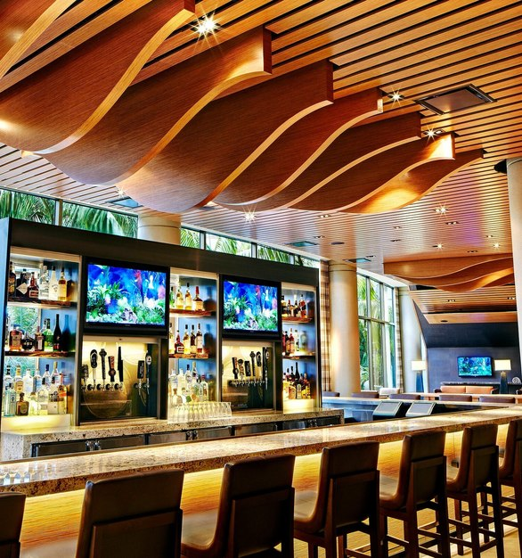 The bar counter at the San Diego Marriott features Prensa embossed wood panels by Materials Inc.