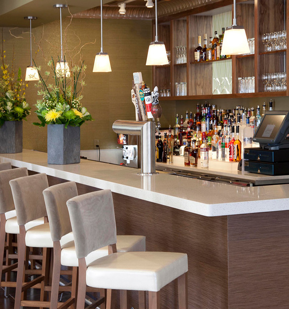 Create a memorable bar counter with Prensa embossed wood panels by Materials Inc.