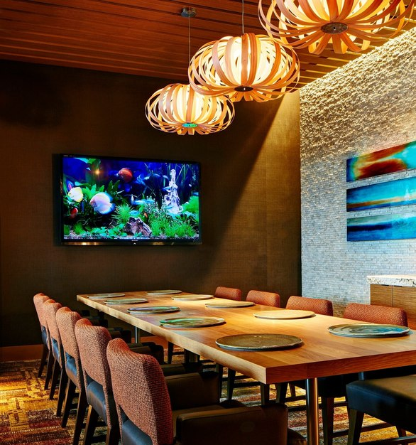 The use of different wall elements creates a unique private dining area at San Diego Marriott, featuring the Prensa embossed wood panels by Materials Inc.