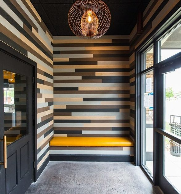 Rockwood Sports Bar's vestibule features Harmony multi-toned wood panels by Materials Inc.