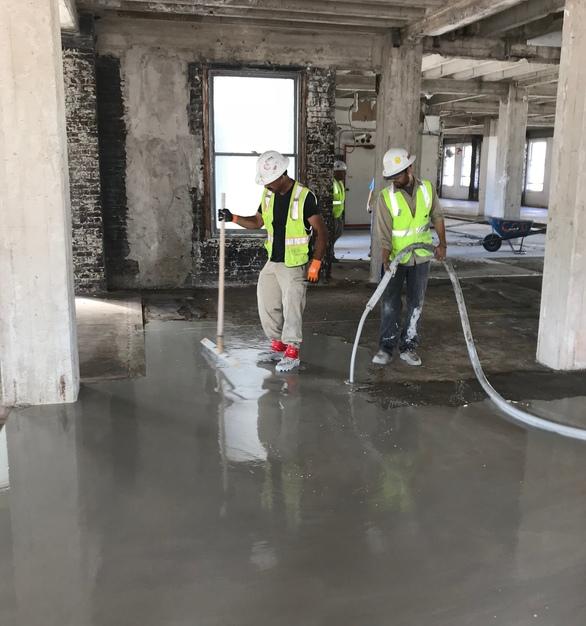 Torbati Building floor before Maxxon's Dura-Cap was used to cap the rough, pitted, cracked and out-of level floor.