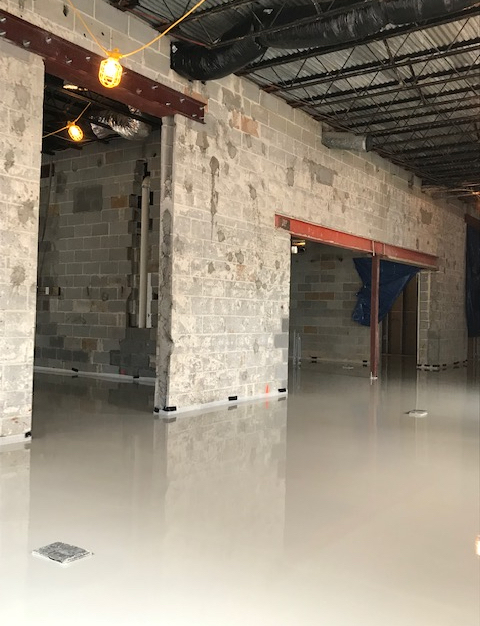 Maxxon's Dura-Cap underlayment was poured at an inch depth above in this old garage which is now ready for its office conversion.