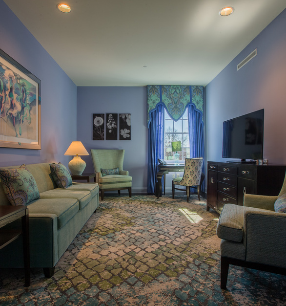 Take a deep breath and unwind in this peacock colored sitting area.  The sound-reducing drywall, by QuietRock helps eliminate sounds from other guest rooms so you can enjoy your room in peace and quiet.