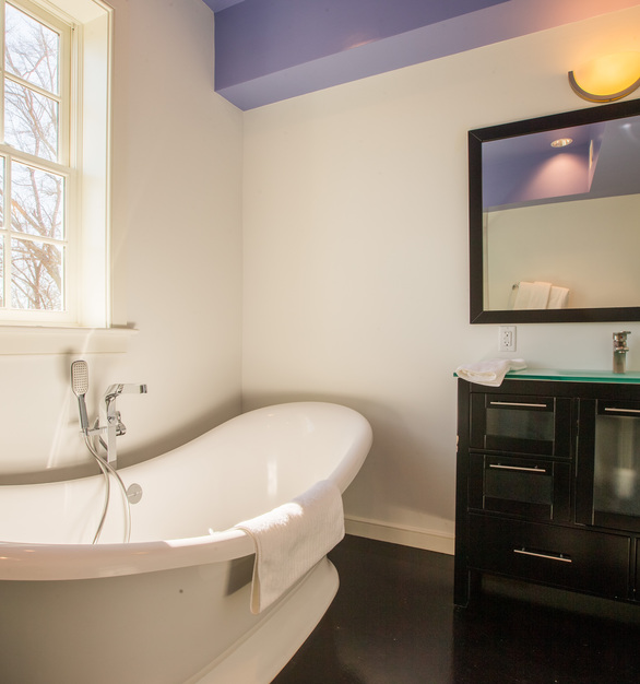 Draw yourself a bubble bath and let the day soak away in this freestanding tub.