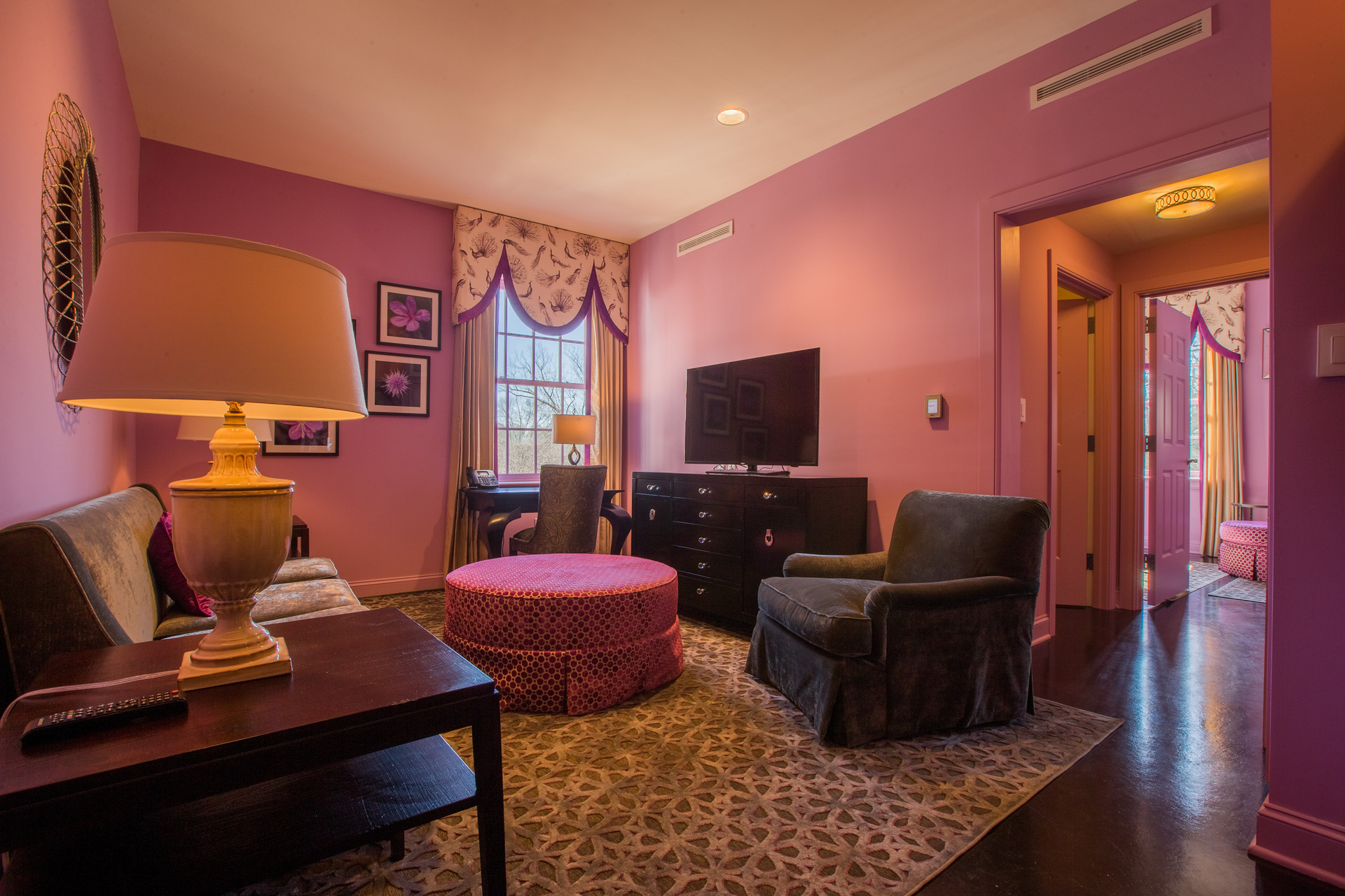Watch a good movie in this pink sitting room at this bed and breakfast.    The hotel owners made sure to take your comfort to heart with installing sound-reducing drywall, by QuietRock so you don't have to worry about listening to other guests.