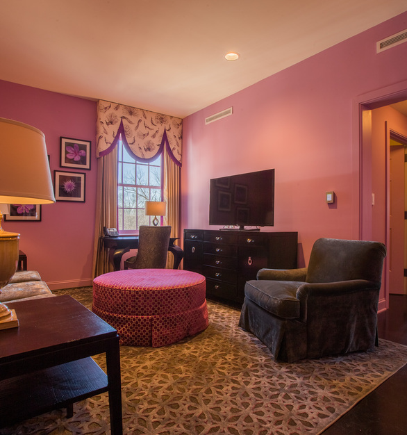 Watch a good movie in this pink sitting room at this bed and breakfast.  