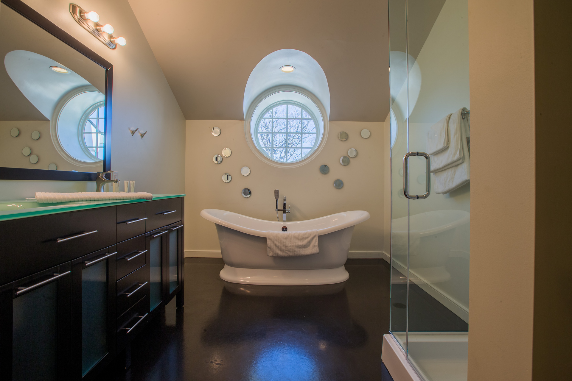 Take a relaxing soak in this freestanding tub or rinse off in the glass shower.    No need to worry about hearing the other hotel guests while soaking in the tub--the sound-reducing drywall installed in each of the rooms creates the perfect sound buffer between rooms.