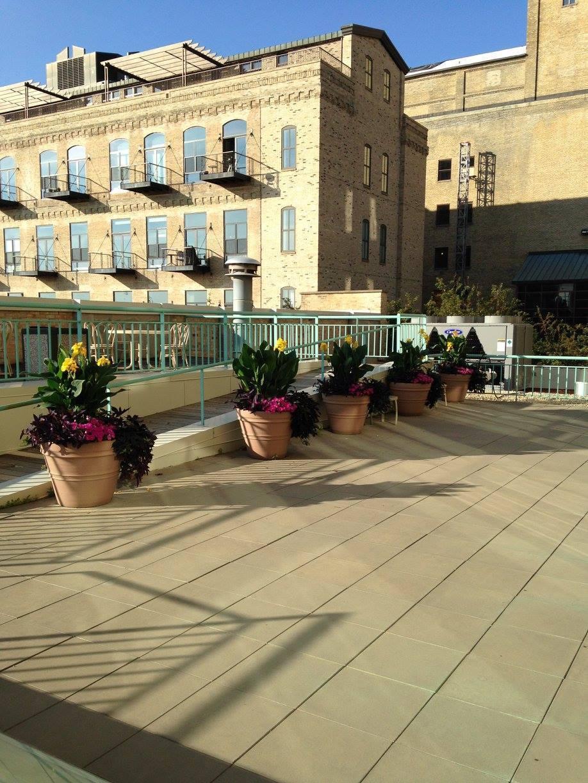 Patio flower pots by McCaren Design.