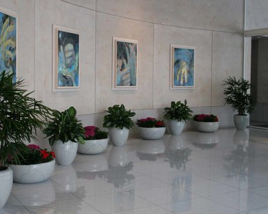 This pristine lobby is brought to life by the flowers and scrubs provided by McCaren Design, Inc.