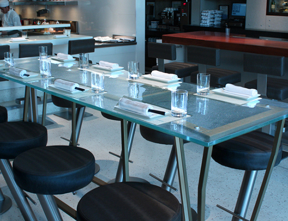 Elegant dining with a custom glass table top in Lukshon located in Culver City, CA