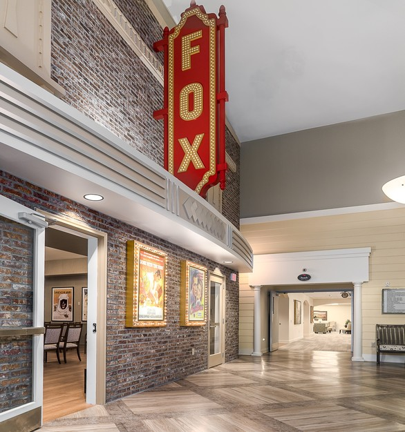 To minimize stress and confusion for residents, every amenity space in the Town Center has its own distinct identity to simplify wayfinding. A replica of Midtown Atlanta's famous Fox Theater sign hangs outside the center's theater, which is decorated with vintage movie posters and includes an old-fashioned popcorn machine.