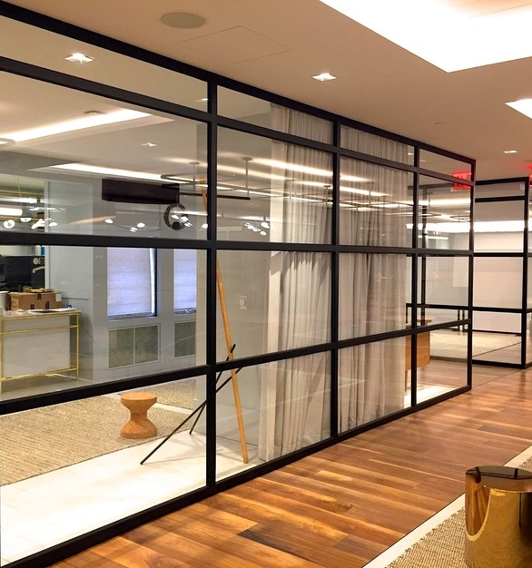 A variety of glass thicknesses may be used with the system to fulfill the need for privacy or sound attenuation. The Slim-Line storefront is provided by Metal Boutique.