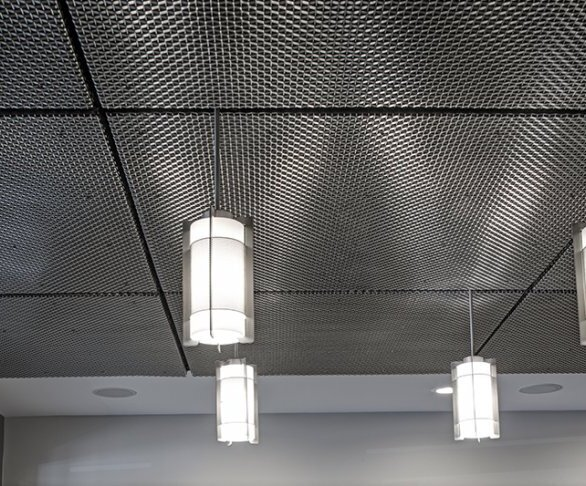 """According to Tom Bialk, GKD's solar engineer and designer, """"The representatives at Commercial Group were looking for a ceiling material that had some acoustical properties but was also attractive. They were particularly drawn to GKD's metal mesh when discovering that its tight weave would partially cover their existing ceiling without being able to see directly through it."""""""